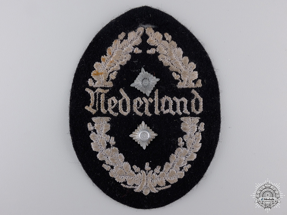 "eMedals-A Dutch ""Nederland"" SS Bau-Einsatz Ost Shield"