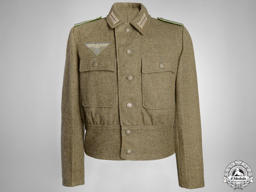 eMedals-A German M44 Combat Tunic with Printed Eagle
