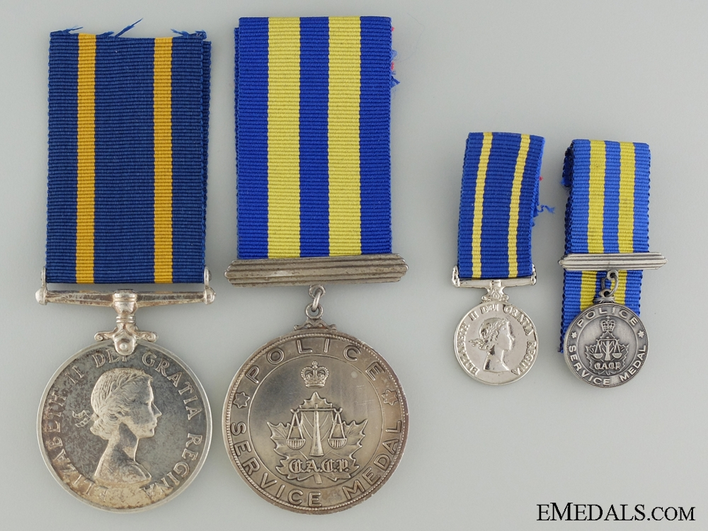 eMedals-A Royal Canadian Mounted Police long Service Pair to F.J.W. Sauriol