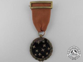 A Spanish Fascist Party Member's Medal