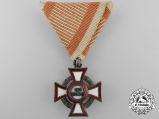An Austrian Military Merit Cross; 3rd Class with War Decoration