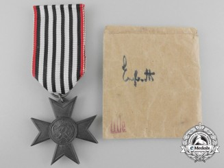 A Prussian War Aid Merit Cross with Packet of Issue