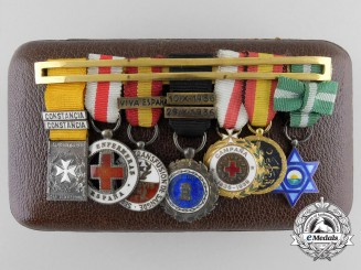 A Spanish Civil War Ladies' Miniature Group of Seven with Case