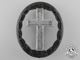 A First War Black Wound Badge; Post-War Converted Example