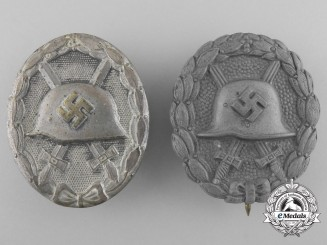 Two Silver Grade Wound Badges