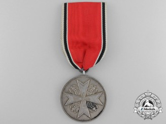 An Order of the German Eagle Medal; Silver Merit Medal