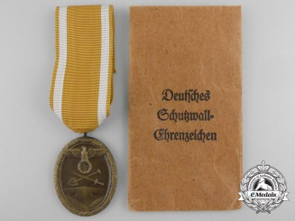 A Mint West Wall Medal with Packet by Julius Maurer