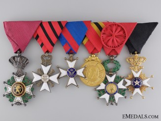 A Belgian Medal Bar with Swedish Order of the North Star in Gold