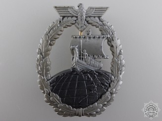 A Kriegsmarine Naval Auxiliary Cruiser War Badge by Foerster & Barth Design