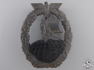 A Kriegsmarine Naval Auxiliary Cruiser Badge by Friedrich Orth