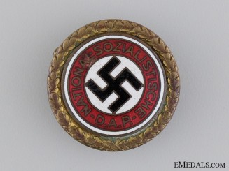 A Large Golden Party Badge