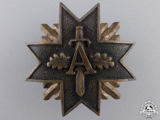 A Pre Second War Latvian Military Badge with Swords