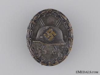 """A Silver Grade Wound Badge; Marked """"30"""""""