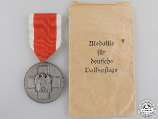 A Social Welfare Medal with Packet of Issue