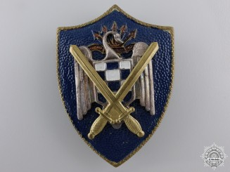 A Spanish Falange Army Badge