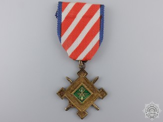 A Vietnamese Staff Service Medal; 2nd Class for NCO's and Enlisted Men