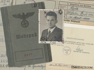 A Wehrpass and Documents to the 353 Regiment; 1940 Accident