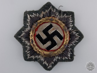 An Army Issue German Cross in Gold; Cloth Version