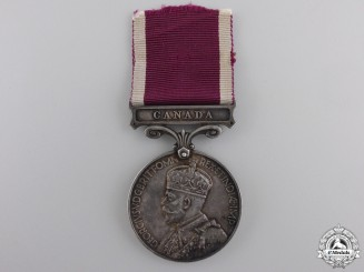 An Army Long Service & Good Conduct Medal with Canada Bar to the R.C.R.