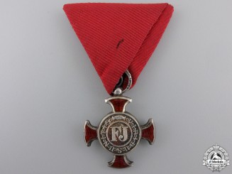 An Austrian Merit Cross 1849; 4th Class by Wilhelm Kunz