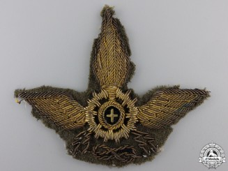 An Italian Colonial Forces Motorized Unit Cap Badge