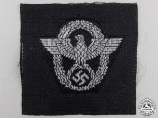An M43 Police Overseas Cap Insignia; Second Pattern