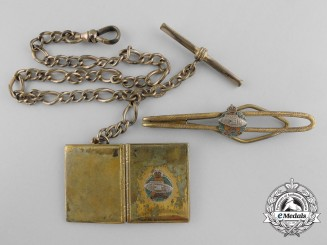 A Second War Canadian Armoured Corps Locket and Clip