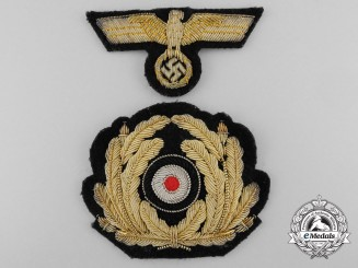 A Second War Kriegsmarine Officers Visor Wreath and Cap Eagle