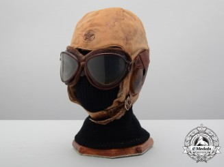 An Imperial Japanese Army Winter Flying Helmet with Cat's Eye Goggles