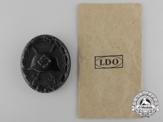 A Black Grade Wound Badge with LDO Packet of Issue