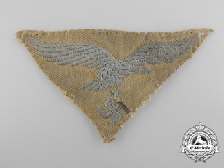 An Uniform Removed and Field Repaired Tropical Luftwaffe Cloth Eagle