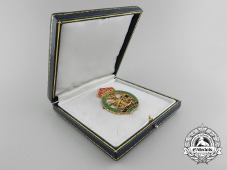 A Brunei Officer's Meritorious Service Badge in 18Kt Gold