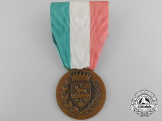 An Italian Medal for Financial Advisor to Somalia 1950 Bronze, 32 mm, original ribbon, oxidation spots on the reverse, light contact, very fine.