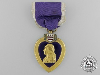 A Purple Heart to Lt. Colonel John W. Therrell who was Wounded in Action in Vietnam