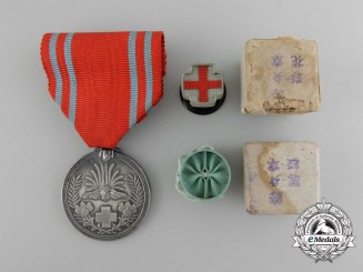 A Japanese Red Cross Society Life Membership Medal with Matching Buttonhole Rosette