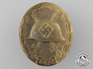 An Early Gold Grade Wound Badge; Marked 30