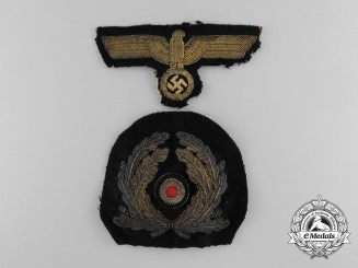 A Worn Second War Kriegsmarine Officers Visor Wreath and Cap Eagle