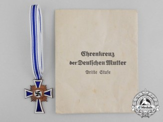 A Bronze Grade Mother's Cross with Original Packet of Issue