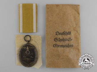 A Near Mint West Wall medal with Packet by Julius Maurer