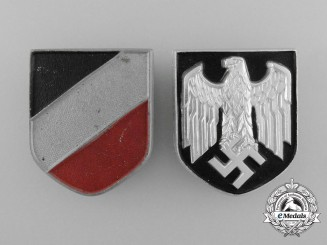 A Set of German Tropical Pith Helmet Insignia