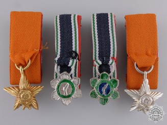 Four Miniature Nepalese Orders