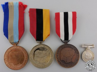 Four Nigerian Medals and Awards
