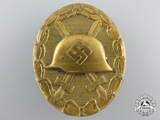 An Early Gold Grade Wound Badge