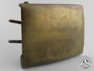 A Brass Finish Neutral Belt Buckle; Published Example