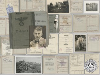 A Wehrpass and Awards Documents to the 4th Panzer Division; Kurland Cufftitle