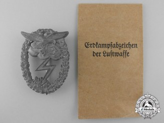 A Luftwaffe Ground Assault Badge with Packet of Issue