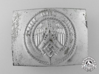 An HJ Belt Buckle by Hermann Aurich; Published with RZM Control Tag