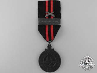A Finnish Winter War 1939-1940 Medal; Type III with Army Clasp
