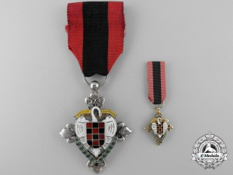 A Spanish Fascist Falange Youth Honour Medal with Miniature
