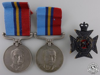 Two Rhodesian General Service Medals and One Cap Badge